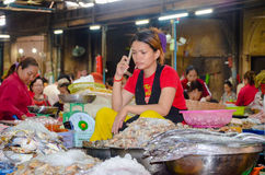 Siem Reap food market, Cambodia. September 5, 2015. Khmer women are coming here daily to sell their products, from fruits and veggies to fresh meat or grains Royalty Free Stock Photo