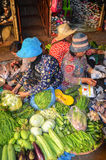 Siem Reap food market, Cambodia. September 5, 2015. Khmer women are coming here daily to sell their products, from fruits and veggies to fresh meat or grains Stock Images