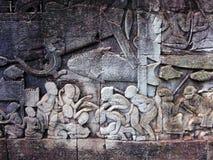 Siem Reap stenvägg som snider detaljen Arkivbilder