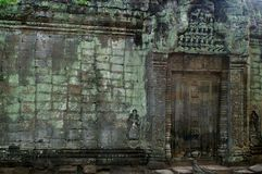 Siem reap wall. Green mossy wall and carved door of angkor cambodia Stock Photos