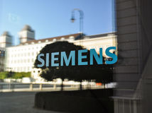 Siemens logo at door of new headquarters - Munich, Germany Stock Image