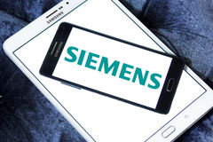 Siemens logo. Logo of german electronics company siemens on samsung mobile phone a5 on samsung tablet tab s2 Stock Photography