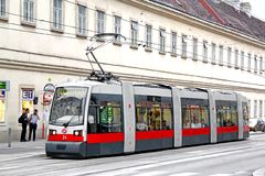 Siemens ULF-A. VIENNA, AUSTRIA - JULY 22, 2014: Red articulated tram Siemens ULF-A at the city street Royalty Free Stock Photos
