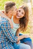 Siempre feliz de conseguir un beso Imagenes de archivo