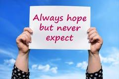 Siempre la esperanza pero nunca espera fotografía de archivo libre de regalías