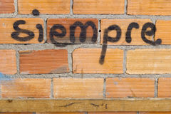 Siempre word written on brickwall Royalty Free Stock Photos