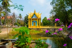 Siemreap,Cambodia.A small Golden temple by the lake. A beautiful old temple in the city Siemreap,Cambodia stock photo