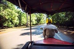 SIEMREAP - JUNE 10, 2015: An unidentified tuktuk driver entering Royalty Free Stock Photo