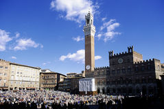 Siena. The Piazza del Campo with Palazzo Pubblico, a major touristic attraction of Siena - Tuscany - italy Stock Photography