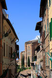 Siena. Narrow street with old buildings in Siena, Italy Stock Photos