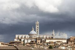 Siena, Cathedral Cattedrale di Santa Maria Assunta with old town, Tuscany, Italy Stock Photos