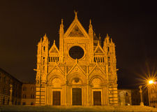Siena cathedral illuminated by night, Tuscany, Italy Stock Photo