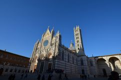 Siena Cathedral, sky, spire, landmark, building. Siena Cathedral is sky, building and cathedral. That marvel has spire, medieval architecture and place of royalty free stock photography