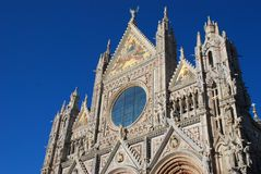 Siena Cathedral, spire, landmark, building, cathedral. Siena Cathedral is spire, cathedral and gothic architecture. That marvel has landmark, place of worship royalty free stock images