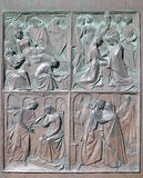Siena Cathedral, Tuscany, Siena, Italy. Details of the bronze bas-relief decoration of the Siena Cathedral doorway in historic city of Siena, Tuscany, Italy Royalty Free Stock Photos