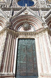 Siena Cathedral, Tuscany, Siena, Italy. Details of the doorway of the Siena Cathedral in historic city of Siena, Tuscany, Italy. Siena Cathedral, Metropolitan Royalty Free Stock Image