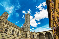 Siena cathedral under a grey cloudy sky. Italy Royalty Free Stock Image