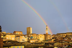 Siena, Italien, mit Regenbogen Stockfotos
