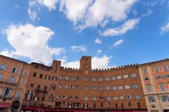 SIENA, ITALY – MAY 25, 2017: Campo Square Piazza del Campo, Palazzo Pubblico and Mangia Tower Torre del Mangia. Stock Images