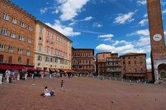 SIENA, ITALY – MAY 25, 2017: Campo Square Piazza del Campo, Palazzo Pubblico and Mangia Tower Torre del Mangia. Royalty Free Stock Photos