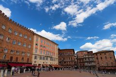 SIENA, ITALY – MAY 25, 2017: Campo Square Piazza del Campo, Palazzo Pubblico and Mangia Tower Torre del Mangia. Royalty Free Stock Photo