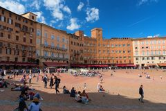 SIENA, ITALY – MAY 25, 2017: Campo Square Piazza del Campo, Palazzo Pubblico and Mangia Tower Torre del Mangia. Royalty Free Stock Photography