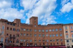 SIENA, ITALY – MAY 25, 2017: Campo Square Piazza del Campo, Palazzo Pubblico and Mangia Tower Torre del Mangia. Stock Photos