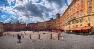 SIENA, ITALY – MAY 25, 2017: Campo Square Piazza del Campo, Palazzo Pubblico and Mangia Tower Torre del Mangia. Royalty Free Stock Image