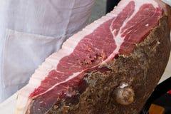 Typical tuscany ham. Siena italy hand cutting typical tuscany ham royalty free stock photo
