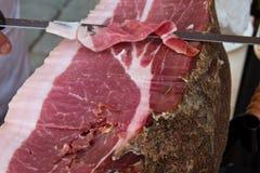 Typical tuscany ham. Siena italy hand cutting typical tuscany ham royalty free stock photography