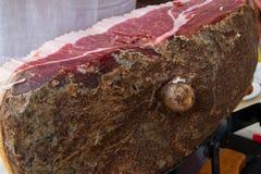Typical tuscany ham. Siena italy hand cutting typical tuscany ham stock image