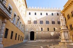 Siena landmark. Monte dei Paschi di Siena historical seat. SIENA, ITALY - January, 04, 2017 : Panorama of Piazza Salimbeni. In the background Palazzo Salimbeni Royalty Free Stock Photos