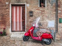 A Vespa parked outside of a Italian House royalty free stock photos