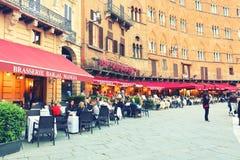 SIENA ITALY - May 10 2018: tourists enjoy Piazza del Campo Royalty Free Stock Image