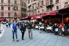 SIENA ITALY - May 10 2018: tourists enjoy Piazza del Campo Royalty Free Stock Images