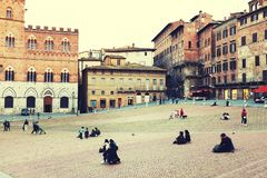 SIENA ITALY - May 10 2018: tourists enjoy Piazza del Campo Stock Image