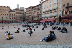 SIENA ITALY - May 10 2018: tourists enjoy Piazza del Campo Stock Images