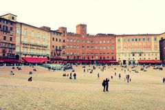 SIENA ITALY - May 10 2018: tourists enjoy Piazza del Campo Royalty Free Stock Photography