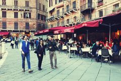 SIENA ITALY - May 10 2018: tourists enjoy Piazza del Campo Royalty Free Stock Photos