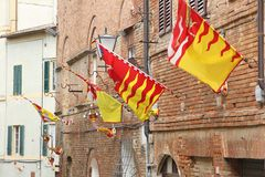 Siena, Italy. Old Town is divided into traditional districts contrade with distinct flags and colors. Valdimontone Valley of the Ram Stock Image