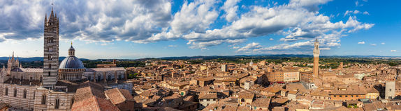 Siena, Italy panorama rooftop city view. Siena Cathedral and Mangia Tower Stock Photography