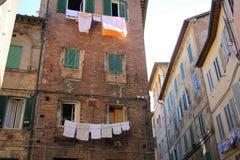 Siena Italy Street Washing Photos stock