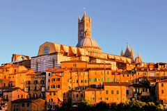 Siena, Italy at sunset Stock Images