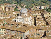 Siena, Italy. A view of the city of Siena, Italy, taken from the City Hall Tower with a domed church (one of many in the city Stock Photography