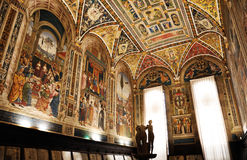 Siena library Piccolomini. Inside view of Siena library Piccolomini. In the middle of the room the beautiful copy of The Three Graces from Roman times, based on Royalty Free Stock Photos