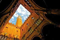 Siena, Palazzo Pubblico - Italy. View from the yard of Palazzo Pubblico in Siena Royalty Free Stock Images