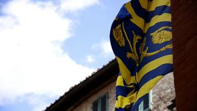 Siena, a palio flag. The Palio di Siena is a traditional medieval horse race run around the Piazza del Campo twice each year, on 2 July and 16 August stock footage