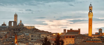 Siena skyline with famous Torre del Mangia at sunset. Tuscany. Italy. Stock Image