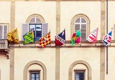 Siena stadsflaggor i Italien Arkivbild