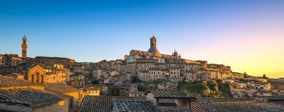 Siena sunset panoramic skyline. Mangia tower and cathedral duomo Royalty Free Stock Image